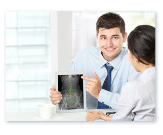 Chiropractor Holding Tablet with Digital X-Ray